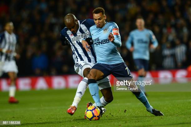 Jacob Murphy of Newcastle United controls the ball whilst being challenged by AllanRomeo Nyon of West Bromwich Albion during the Premier League match...