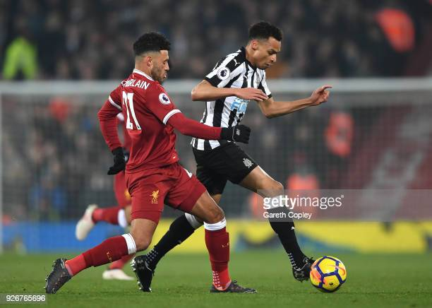 Jacob Murphy of Newcastle United is chased down Alex OxladeChamberlain of Liverpool during the Premier League match between Liverpool and Newcastle...