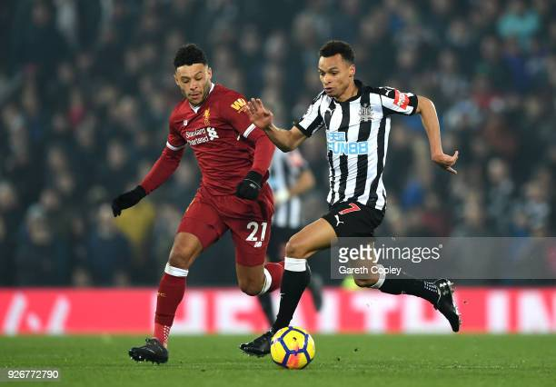 Jacob Murphy of Newcastle United is closed down by Alex OxladeChamberlain of Liverpool during the Premier League match between Liverpool and...