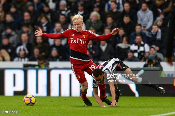 Jacob Murphy of Newcastle United is fouled by Will Hughes of Watford during the Premier League match between Newcastle United and Watford FC at...