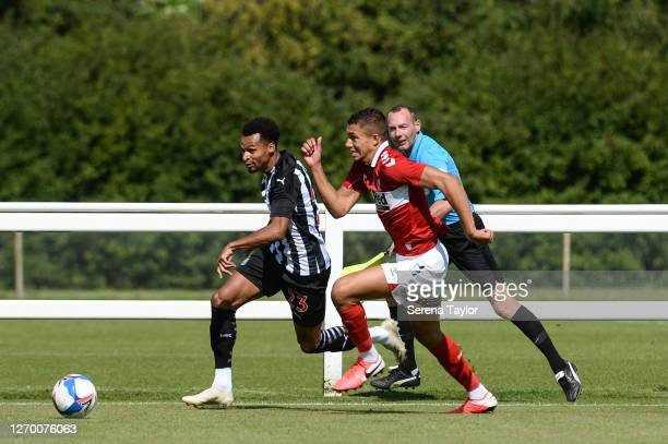 Jacob Murphy of Newcastle United runs with the ball as Nathan Wood of Middlesbrough FC chases during the Pre Season Friendly between Newcastle United...
