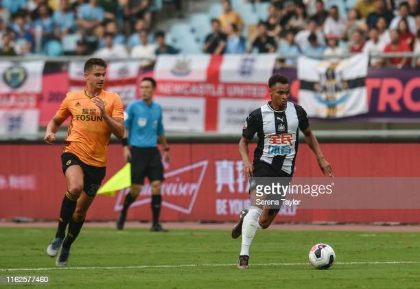 Jacob Murphy of Newcastle United runs with the ball during the Premier League Asia Trophy match between Newcastle United and Wolverhampton Wanderers...