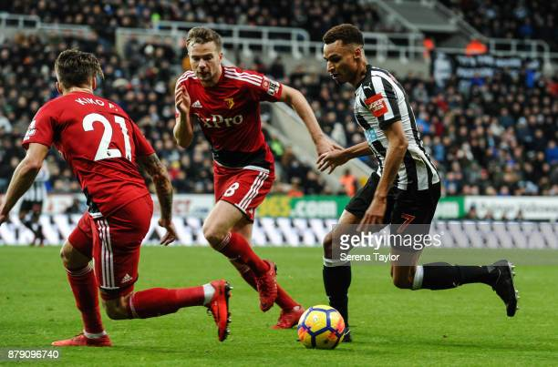 Jacob Murphy of Newcastle United runs with the ball whilst being defended by Kiko Femenia of Watford and Tom Cleverley of Watford during the Premier...