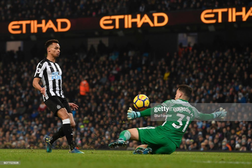 Jacob Murphy of Newcastle United scores his sides first goal past Ederson of Manchester City during the Premier League match between Manchester City and Newcastle United at Etihad Stadium on January 20, 2018 in Manchester, England.