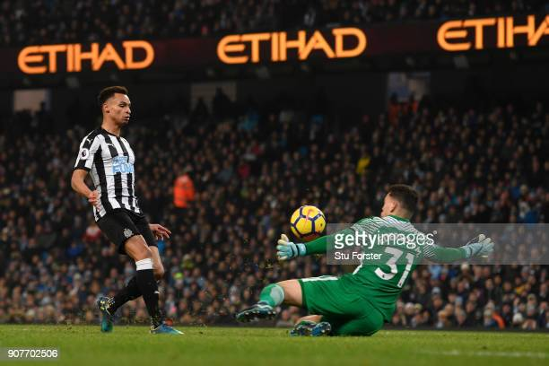 Jacob Murphy of Newcastle United scores his sides first goal past Ederson of Manchester City during the Premier League match between Manchester City...