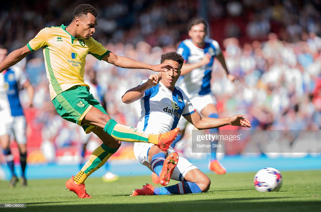 Jacob Murphy of Norwich City is tackled by Adam Henley of Blackburn Rovers during the Sky Bet Championship match between Blackburn Rovers and Norwich City at Ewood park on August 6, 2016 in Blackburn, England.