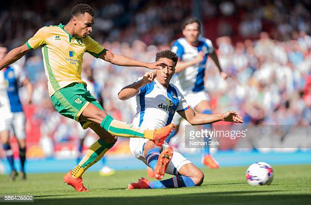 Jacob Murphy of Norwich City is tackled by Adam Henley of Blackburn Rovers during the Sky Bet Championship match between Blackburn Rovers and Norwich...