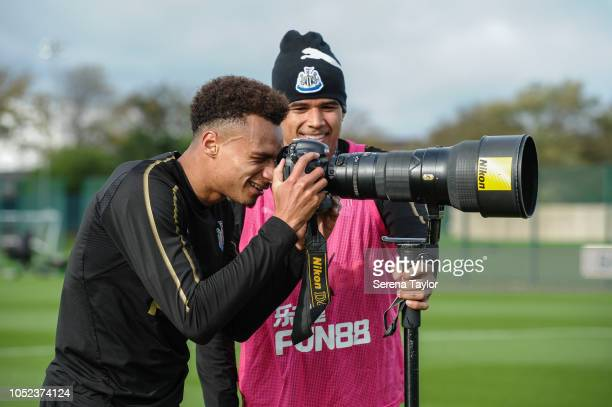 Jacob Murphy takes a photo whilst Kenedy looks on during the Newcastle United Training Session at The Newcastle United Training Centre on October 17...