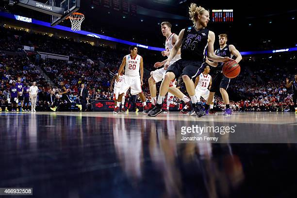 Jacob Parker of the Stephen F. Austin Lumberjacks handles the ball in the second half against the Utah Utes during the second round of the 2015 NCAA...