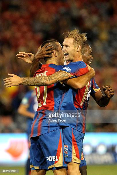 Jacob Pepper of the Jets celebrates a goal with team mates during the round 16 A-League match between the Newcastle Jets and Brisbane Roar at Hunter...