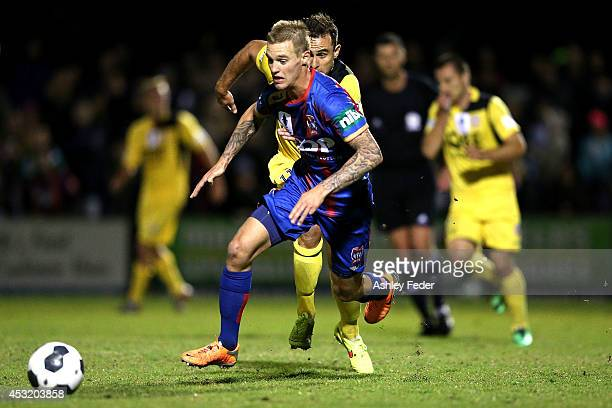 Jacob Pepper of the Jets controls the ball ahead of Richard Garcia of the Glory during the FFA Cup match between the Newcastle Jets and the Perth...