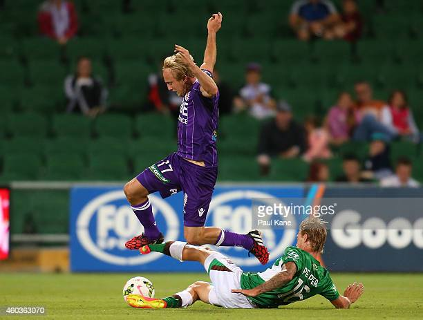 Jacob Pepper of the Jets tackles Mitch Nichols of the Glory during the round 11 ALeague match between Perth Glory and Newcastle Jets at nib Stadium...