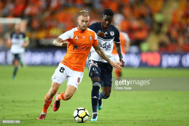 Jacob Pepper of the Roar and Leroy George of Vivtory compete for the ball during the round 11 ALeague match between the Brisbane Roar and the...