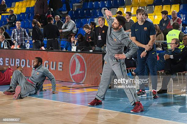 Jacob Pullen #00 of FC Barcelona and Juan Carlos Navarro #11 stretching before the 20132014 Turkish Airlines Euroleague Top 16 Date 6 game between FC...