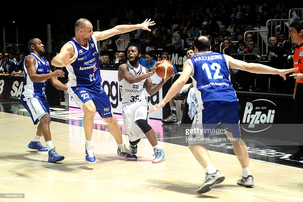Jacob Pullen of Oknoplast competes with Jonathan Tabu #18, Marco Cusin #22 and Nicola Mazzarino # 12 of Lenovo during the LegaBasket A1 basketball match between Oknoplast Bologna and Lenovo Cantu at Unipol Arena on May 5, 2013 in Bologna, Italy.