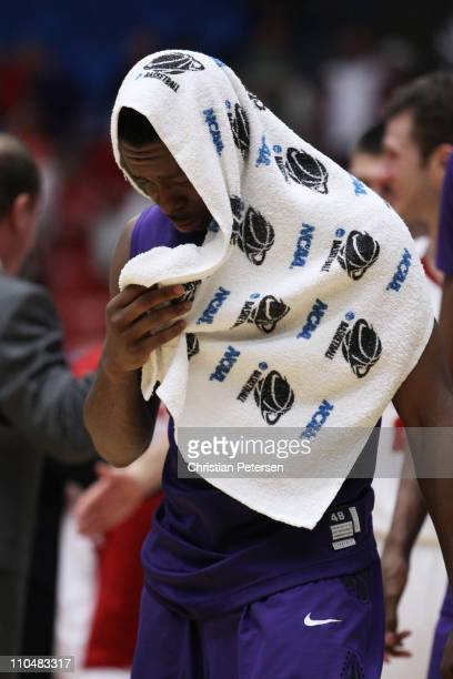 Jacob Pullen of the Kansas State Wildcats walks off of the court dejected after their 65 to 70 loss to the Wisconsin Badgers during the third round...