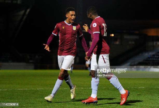 Jacob Ramsey of Aston Villa celebrates with teammate Colin Odutayo after scoring his team's first goal during the Premier League 2 match between...