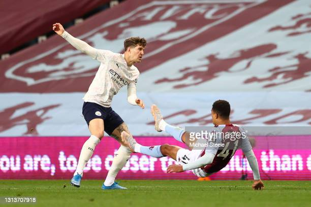Jacob Ramsey of Aston Villa is challenged by John Stones of Manchester City leading to him later being shown a red card after a VAR review during the...