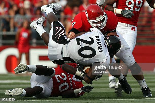 Jacob Ramsey of the Cincinnati Bearcats is tackled by Ryan D'Imperio of the Rutgers Scarlet Knights at Rutgers Stadium on September 7 2009 in...
