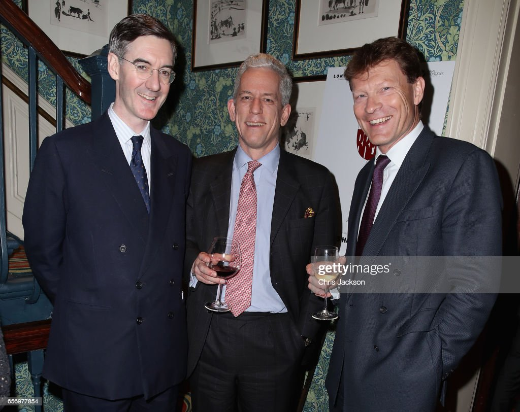Jacob Rees-Mogg (L) and guests the Glass Half Full party at Mark's Club on March 23, 2017 in London, United Kingdom.