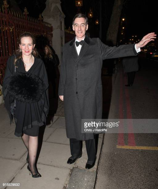 Jacob ReesMogg hails a taxi as he leaves the Conservative party Black and White Ball at Natural History Museum on February 7 2018 in London England...