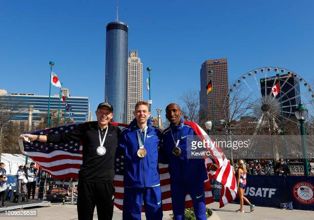 Jacob Riley Galen Rupp and Abdi Abdirahman pose together after finishing in the top three of the Men's US Olympic marathon team trials on February 29...