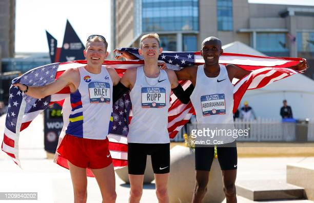 Jacob Riley, Galen Rupp, and Abdi Abdirahman pose together after finishing in the top three of the Men's U.S. Olympic marathon team trials on...