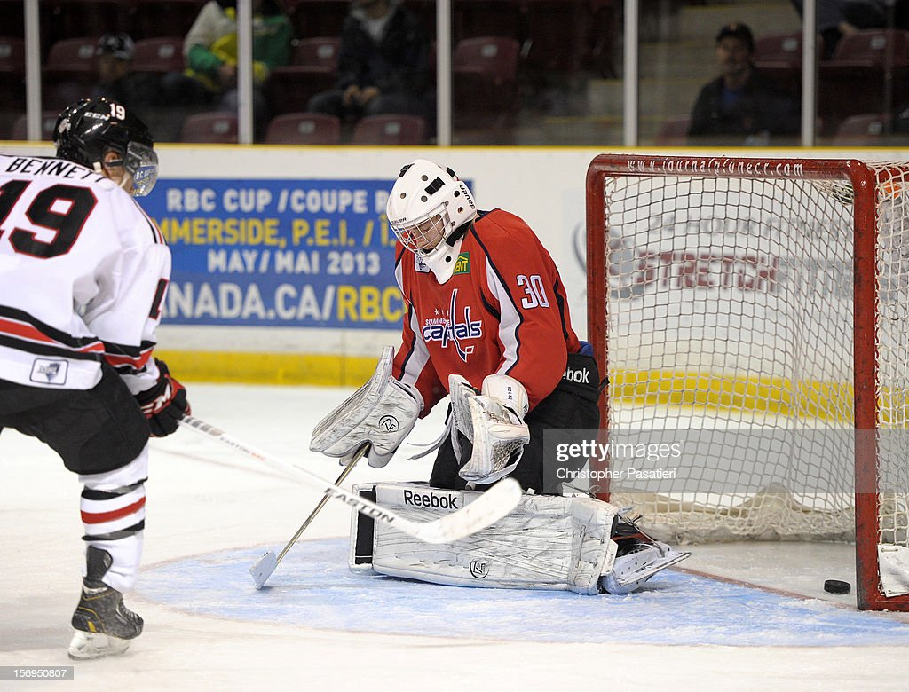 Jacob Riley #30 of the Summerside Western Capitals allows a goal during the second period against the Weeks Crushers on November 25, 2012 at the Consolidated Credit Union Place in Summerside, Prince Edward Island, Canada.