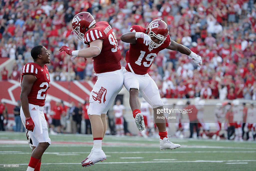 Jacob Robinson #91 and Tony Fields #19 of the Indiana Hoosiers celebrate after Fields intercepted a pass during the game aganst the Nebraska Cornhuskers at Memorial Stadium on October 15, 2016 in Bloomington, Indiana.