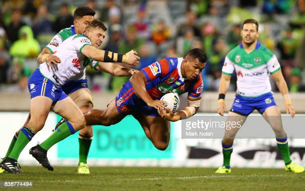 Jacob Saifiti of the Knights is tackled during the round 25 NRL match between the Canberra Raiders and the Newcastle Knights at GIO Stadium on August...
