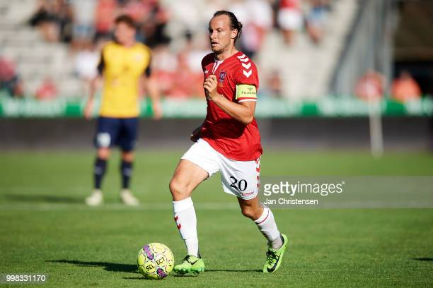 Jacob Schoop of Vejle Boldklub controls the ball during the Danish Superliga match between Vejle Boldklub and Hobro IK at Vejle Stadion on July 13...