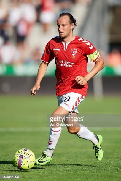 Jacob Schoop of Vejle Boldklub controls the ball during the Danish Superliga match between Vejle Boldklub and Hobro IK at Vejle Stadion on July 13...