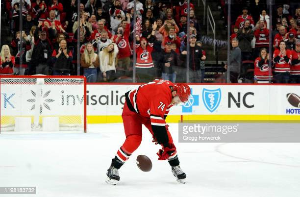 Jacob Slavin of the Carolina Hurricanes participates in a Storm Surge after defeating the Vancouver Canucks during an NHL game on February 2 2020 at...