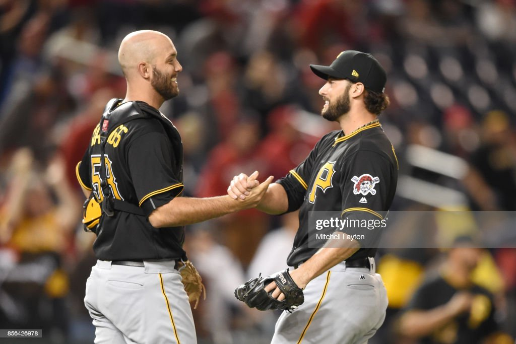 Jacob Stallings #58 of the Pittsburgh Pirates and George Kontos #70 of the Pittsburgh Pirates celebrates a win after a baseball game against the Washington Nationals at Nationals Park on October 1, 2017 in Washington, DC.