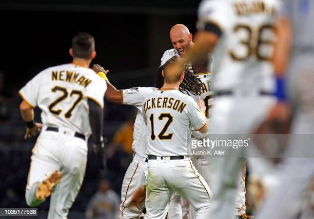 Jacob Stallings of the Pittsburgh Pirates celebrates after hitting a walk off RBI single in the ninth inning against the Kansas City Royals during...