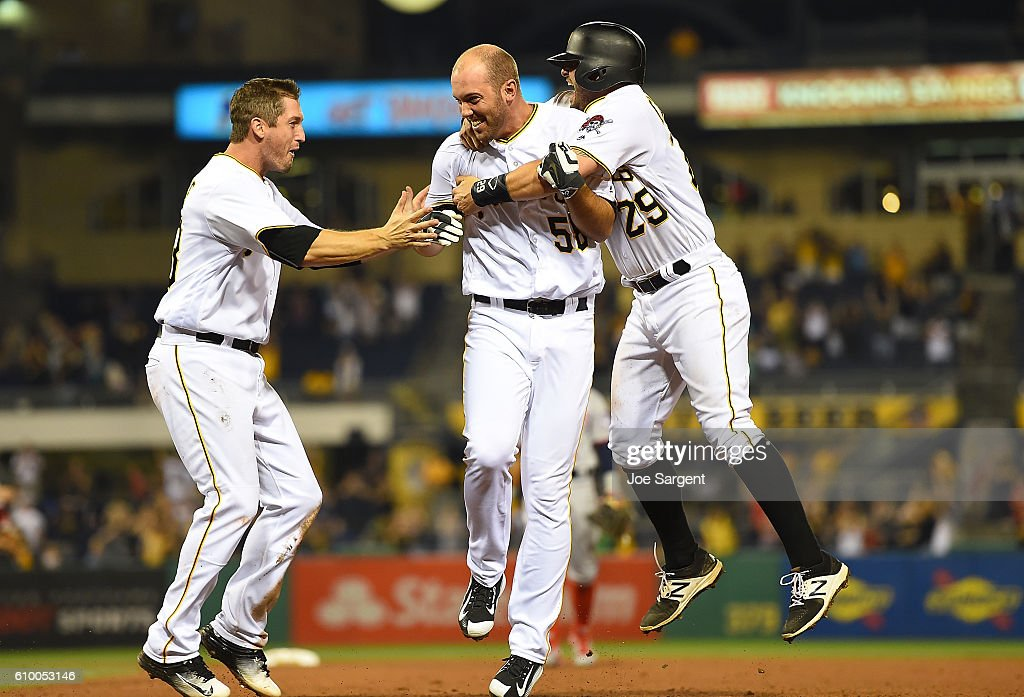 Jacob Stallings #58 of the Pittsburgh Pirates celebrates his game winning RBI single with Francisco Cervelli #29 and David Freese #23 during the eleventh inning against the Washington Nationals on September 23, 2016 at PNC Park in Pittsburgh, Pennsylvania.
