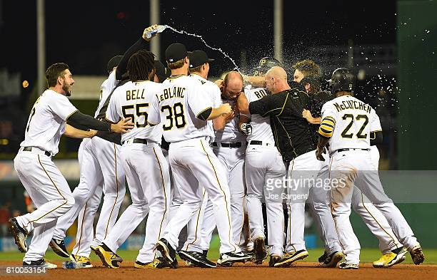 Jacob Stallings of the Pittsburgh Pirates celebrates his game winning RBI single with teammates during the eleventh inning against the Washington...