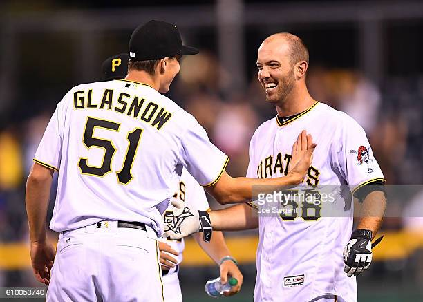 Jacob Stallings of the Pittsburgh Pirates celebrates his game winning RBI single with Tyler Glasnow during the eleventh inning against the Washington...