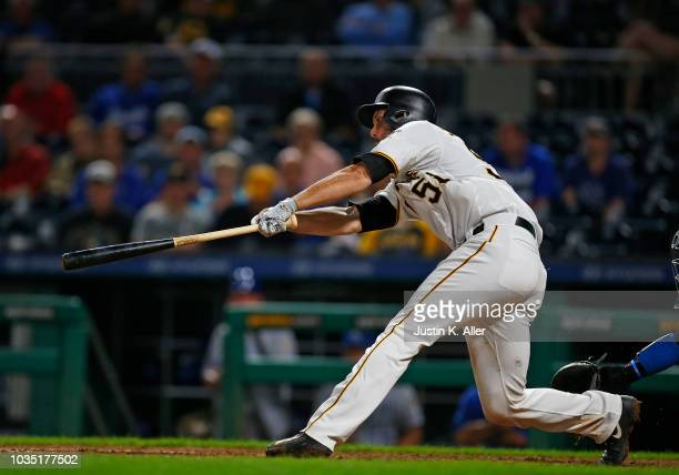 Jacob Stallings of the Pittsburgh Pirates hits a walk off RBI single in the ninth inning against the Kansas City Royals during interleague play at...