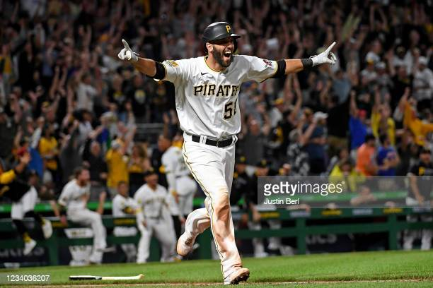 Jacob Stallings of the Pittsburgh Pirates reacts as he rounds the bases after hitting a walk-off grand slam home run to give the Pirates a 9-7 win...