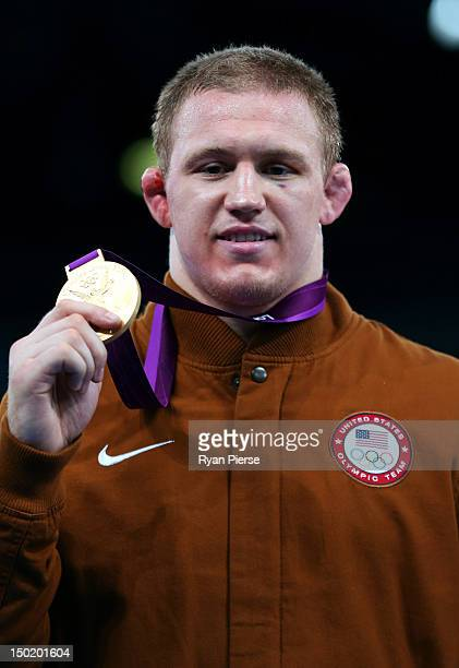 Jacob Stephen Varner of the United States celebrates with his gold medal during the medal ceremony following the Men's Freestyle 96 kg Wrestling gold...