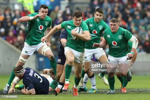 Jacob Stockdale of Ireland breaks clear to score their second try during the Guinness Six Nations match between Scotland and Ireland at Murrayfield...