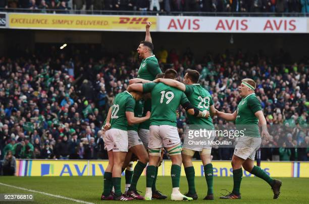 Jacob Stockdale of Ireland celebrates with teammates after scoring a try during the Six Nations Championship rugby match between Ireland and Wales at...