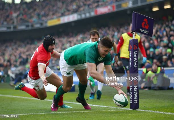 Jacob Stockdale of Ireland dives in for a first half try under pressure from Leigh Halfpenny of Wales during the NatWest Six Nations match between...