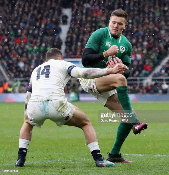 Jacob Stockdale of Ireland is tackled by Jonny May during the NatWest Six Nations match between England and Ireland at Twickenham Stadium on March 17...