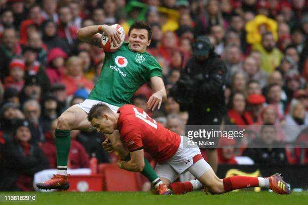 Jacob Stockdale of Ireland is tackled by Liam Williams of Wales during the Guinness Six Nations match between Wales and Ireland at Principality...