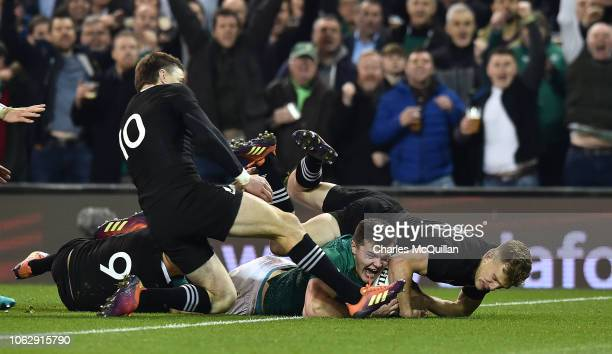 Jacob Stockdale of Ireland scores a try during the International Friendly rugby match between Ireland and New Zealand on November 17 2018 in Dublin...