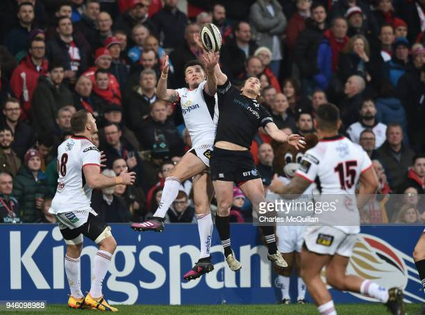 Jacob Stockdale of Ulster and Jeff Hassler of Ospreys during the Guinness Pro14 rugby game at Kingspan Stadium on April 13 2018 in Belfast Northern...