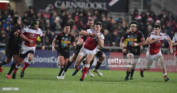 Jacob Stockdale of Ulster is tackled by George Merrick of Harlequins during the European Rugby Champions Cup match between Ulster Rugby and...
