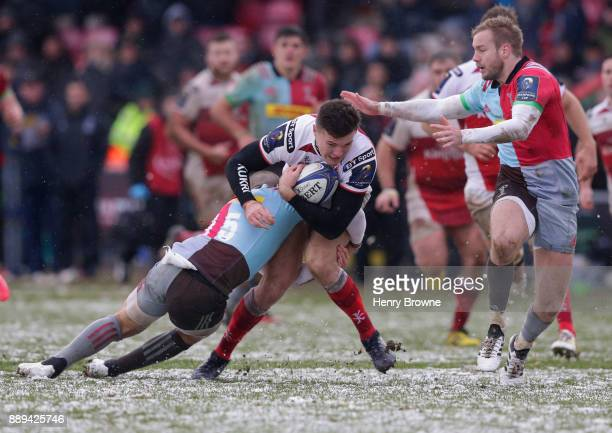 Jacob Stockdale of Ulster is tackled by Mike Brown of Harlequins during the European Rugby Champions Cup match between Harlequins and Ulster Rugby at...